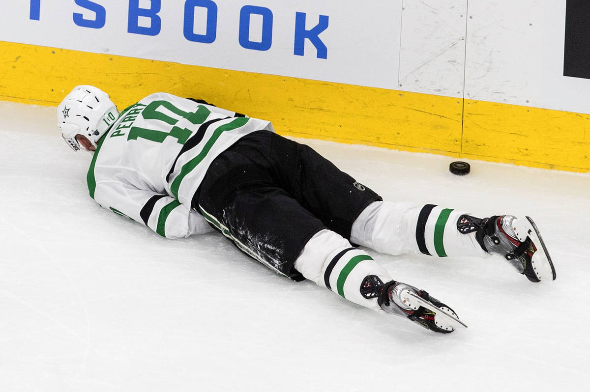 Dallas Stars' Corey Perry (10) lies injured on the ice during second-period NHL Western Confere ...