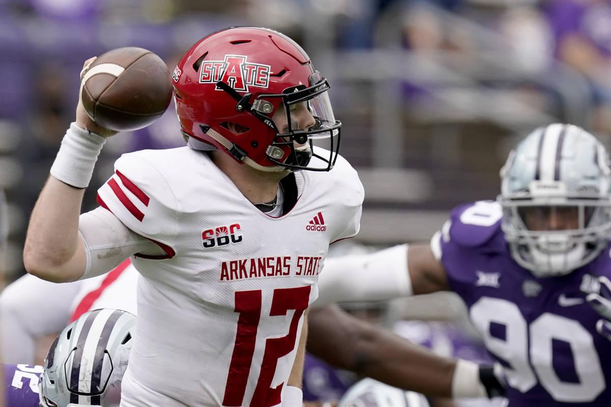 Arkansas State quarterback Logan Bonner throws during the second half of an NCAA college footba ...