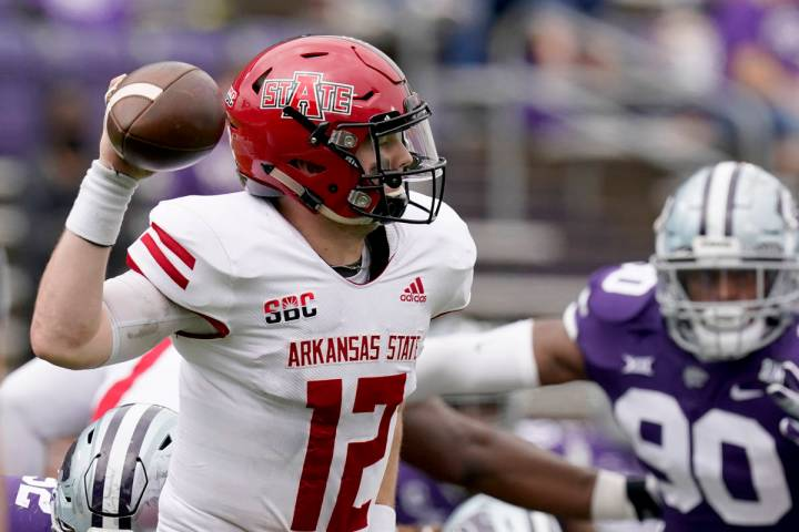 Arkansas State quarterback Logan Bonner throws during the second half of an NCAA college footba ...