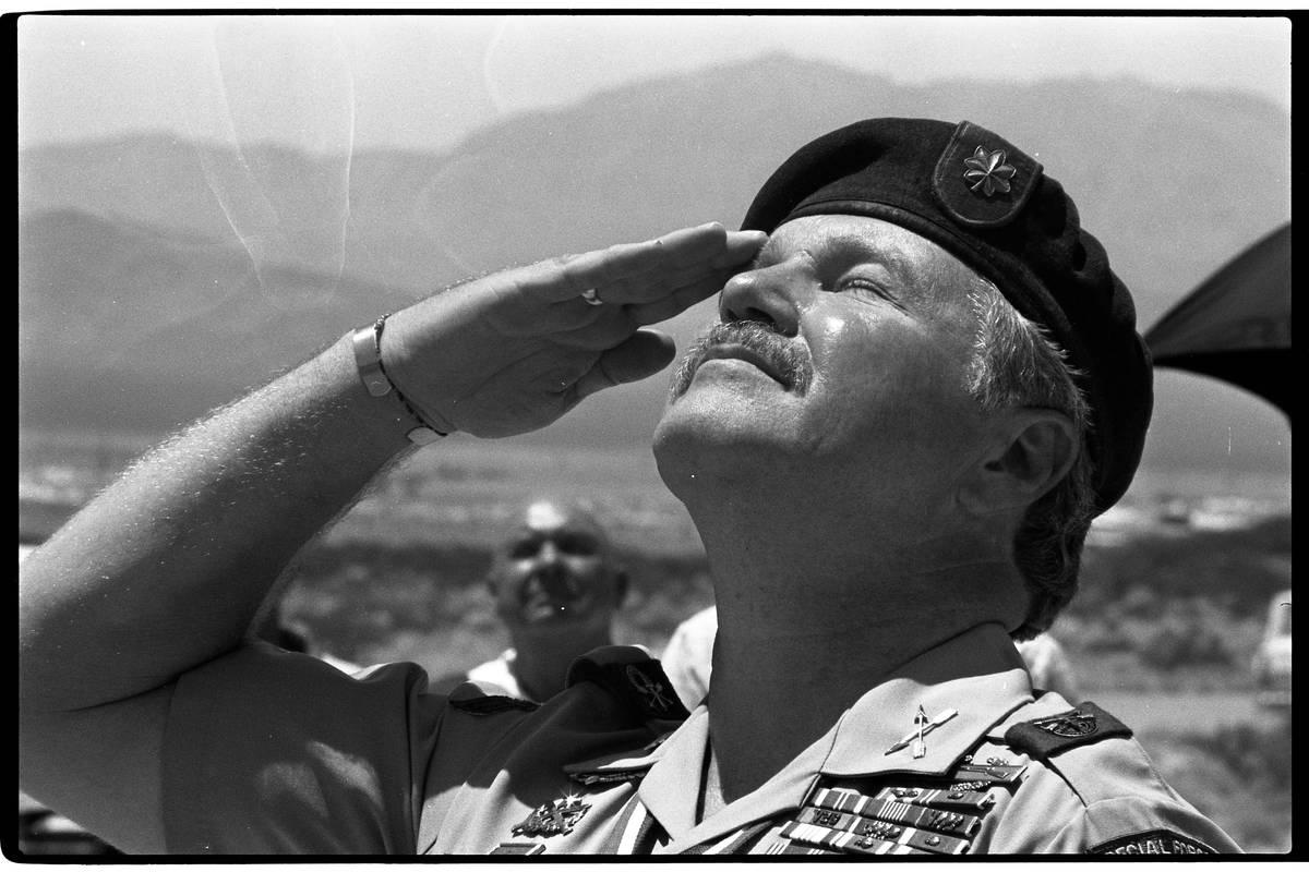 "Retired Green Beret Lt. Col. James ""Bo"" Gritz at a flag-raising ceremony in 1987. (Las vegas Re ..."