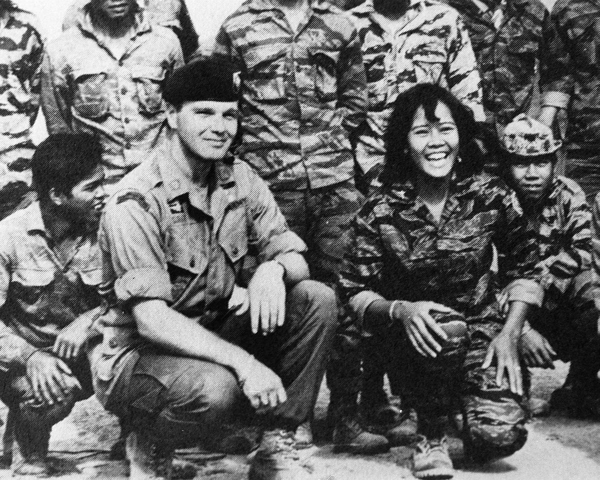 """Special Forces leader James """"Bo"""" Gritz and his friend in combat, Nurse Toi, pose with ..."""
