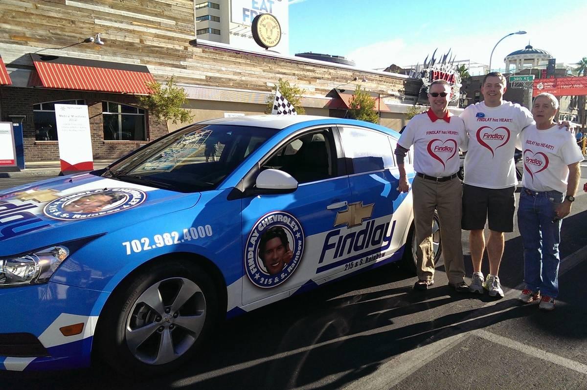 From left, Findlay Automotive CFO Tyler Corder, Findlay Chevrolet General Manager Doug Fleming ...