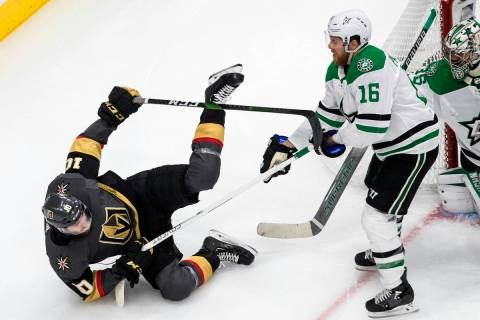 Dallas Stars' Joe Pavelski (16) checks Vegas Golden Knights' Nicolas Roy (10) during second-per ...