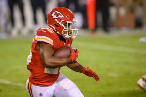 Kansas City Chiefs running back Clyde Edwards-Helaire (25) runs the ball against the Houston Te ...