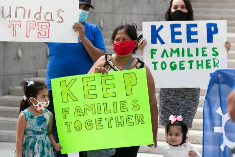 Janette Rivera, center, her daughters Daniella, 5, and Sofia, 2, join Temporary Protective Stat ...