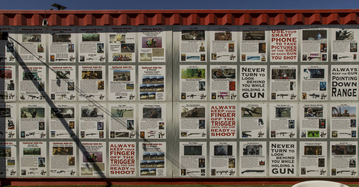 A wall at Adrenaline Mountain displays gun information and more about those available to shoot ...