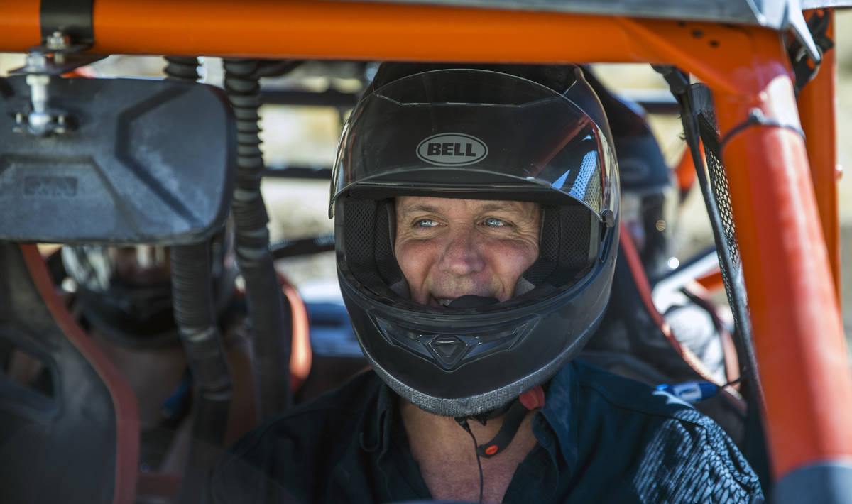 Adrenaline Mountain owner and CEO Eric Brashear wears a safety helmets as he readies to hit the ...