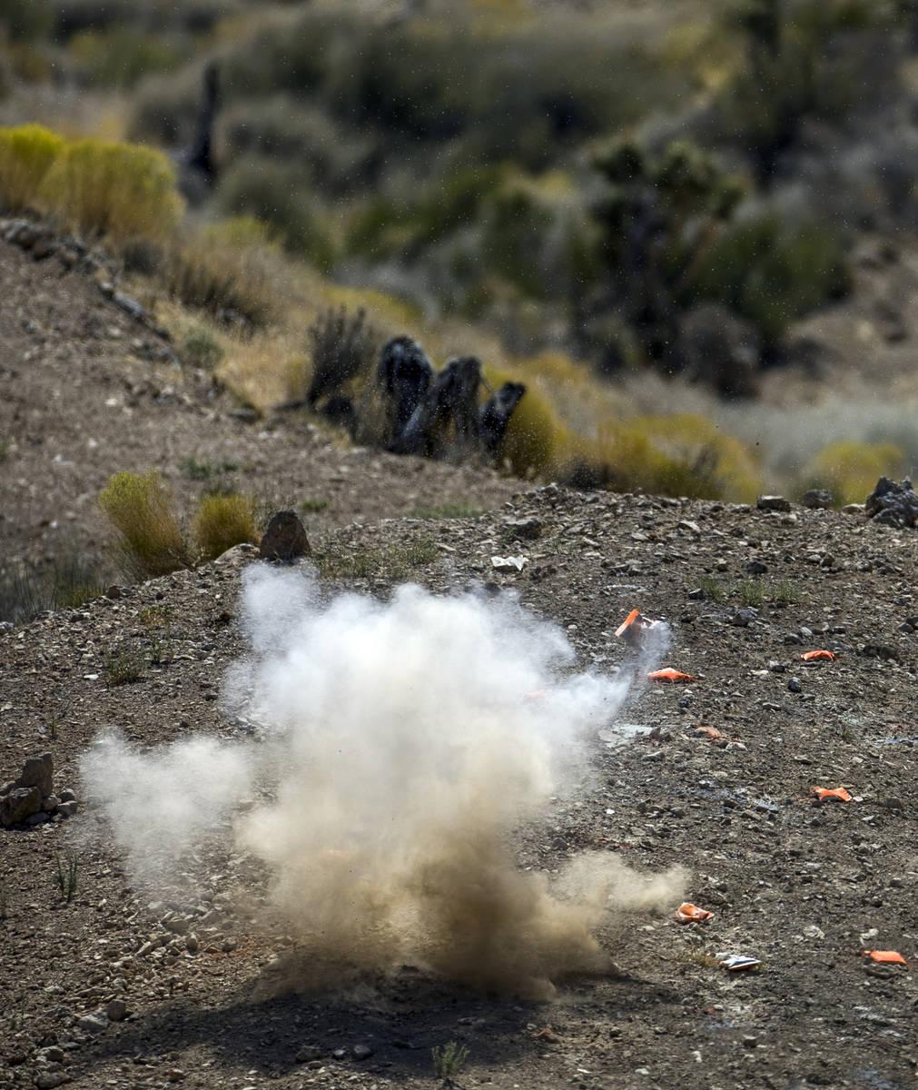 An explosive target blows up on the Adrenaline Mountain gun range, Thursday, Sept. 10, 2020, in ...