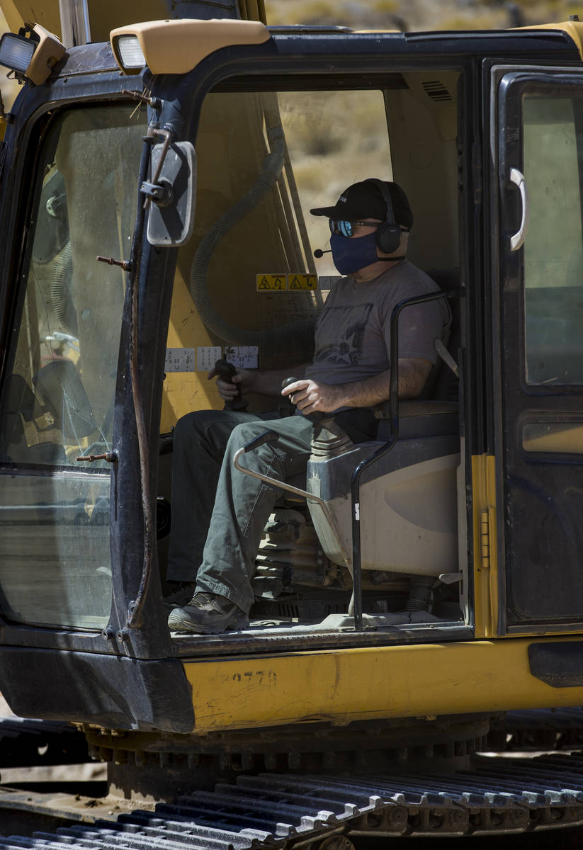 Christopher Lawrence operates a Caterpillar Excavator, one of the extreme outdoor entertainment ...