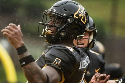 Appalachian State running back Daetrich Harrington (4) celebrates a touchdown in the fourth qua ...