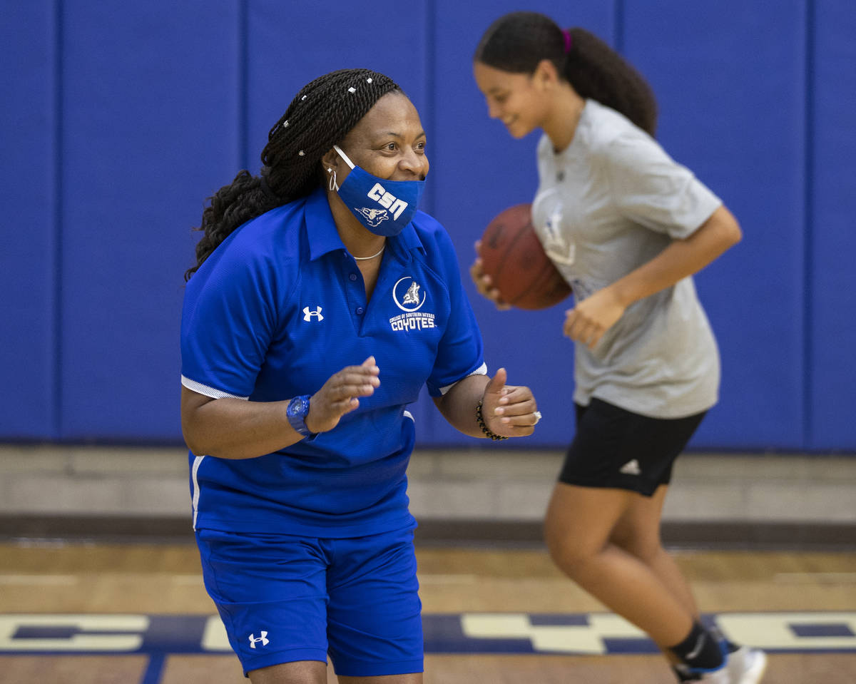 Dorothy Kendrick, left, head women's basketball coach at the College of Southern Nevada, works ...