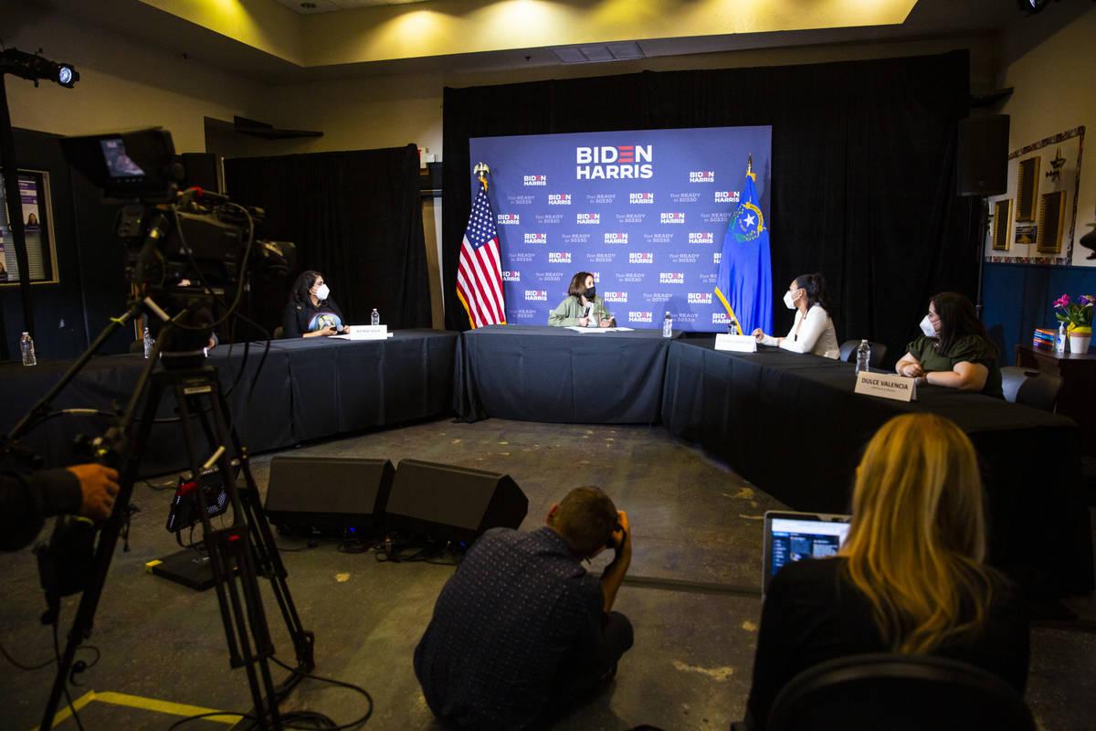 Democratic vice presidential candidate Sen. Kamala Harris, D-Calif., center, speaks during a ro ...