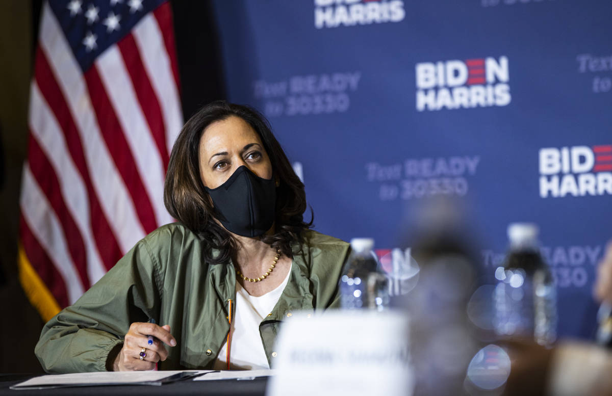 Democratic vice presidential candidate Sen. Kamala Harris, D-Calif., listens during a roundtabl ...