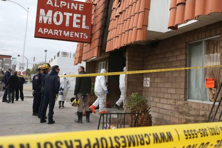 Las Vegas Fire Department investigators with assistance from Las Vegas police enter the Alpine ...