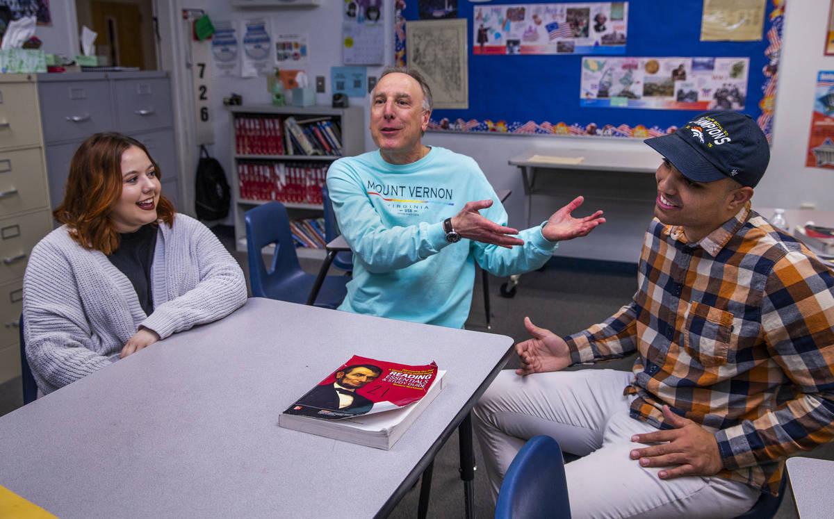 Leavitt Middle School Holocaust teacher Mitchell Kalin, center, talks about their class experie ...