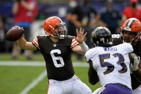 FILE - Cleveland Browns quarterback Baker Mayfield (6) looks to pass during an NFL football gam ...
