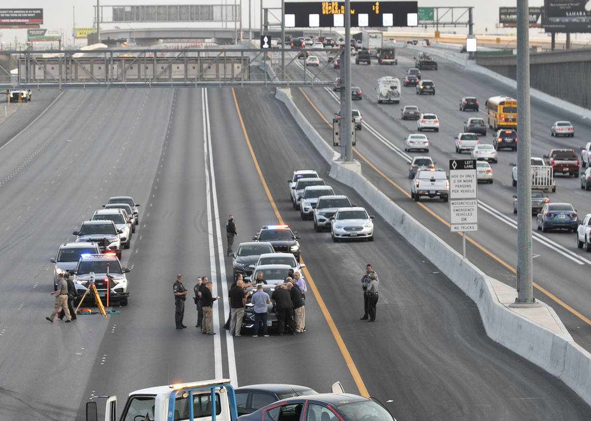 A team of officers and detectives investigate on Southbound I-15 near Flamingo exit on Wednesda ...