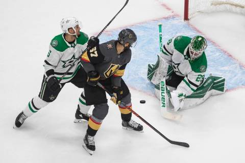 Dallas Stars goalie Jake Oettinger (29) makes a save on Vegas Golden Knights' Max Pacioretty (6 ...