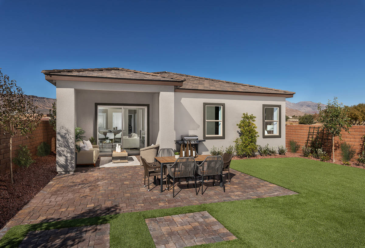 At Stonegate by KB Home in the village of South Square, a charming outdoor patio featuring bric ...