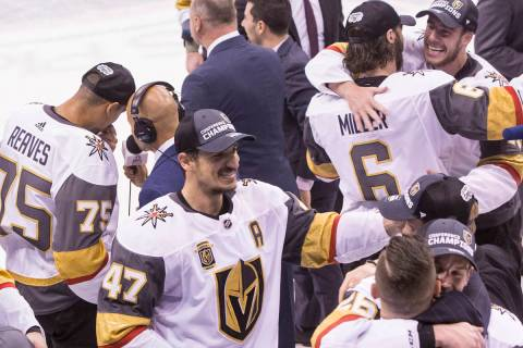 Golden Knights players and staff celebrate after beating the Winnipeg Jets 2-1 to advance to th ...