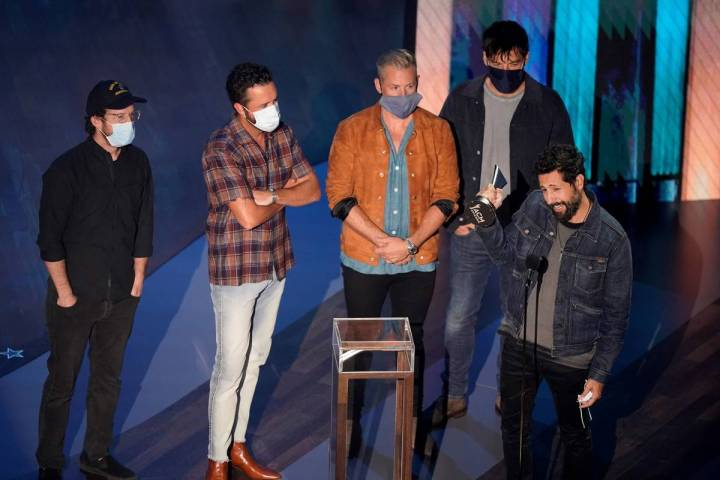 Old Dominion accepts the group of the year award during the 55th annual Academy of Country Musi ...
