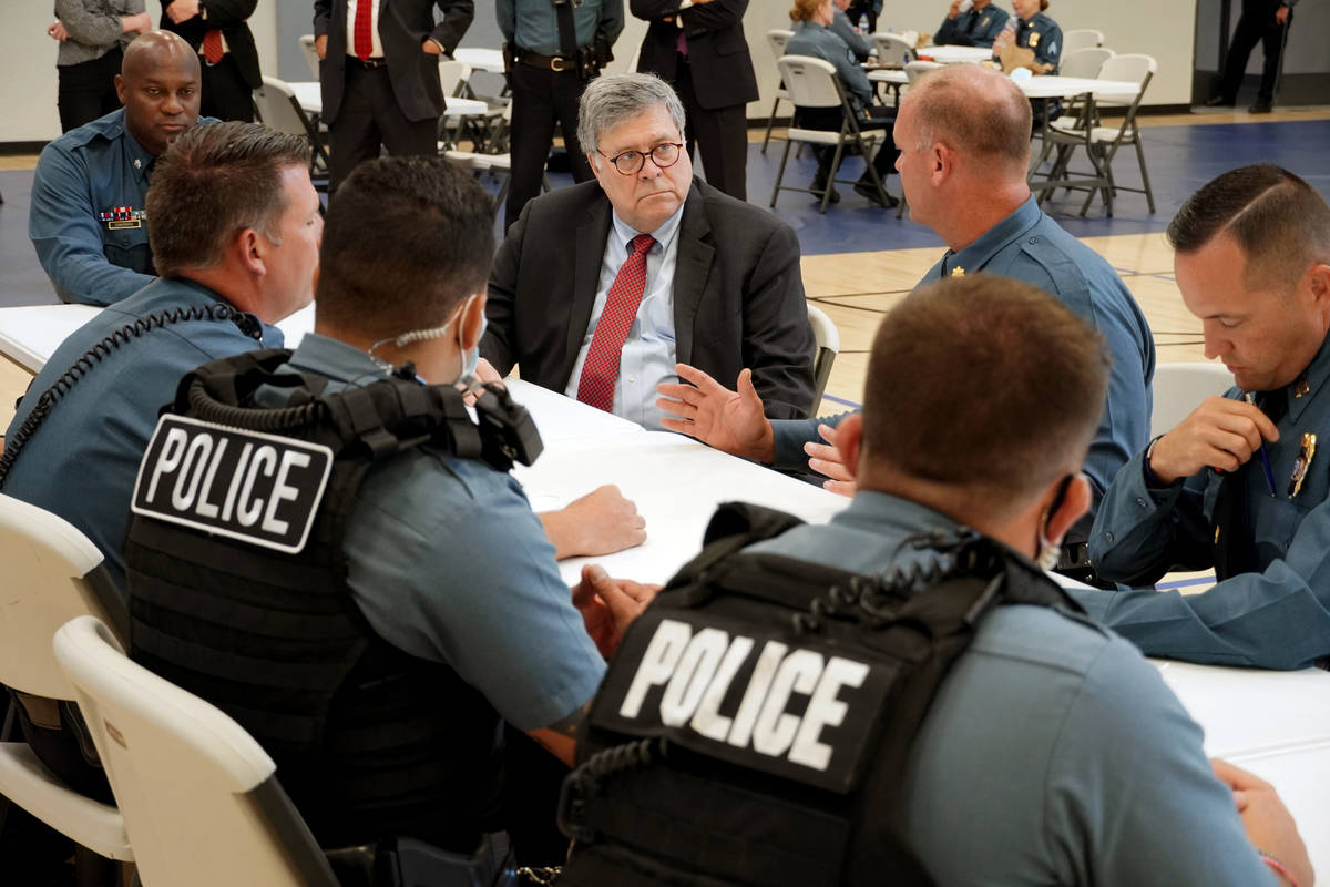FILE - In this Aug. 19, 2020, photo Attorney General William Barr participates in a roll call w ...