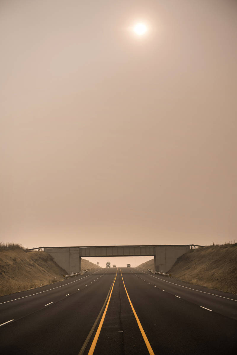 Traffic moves through the wildfire smoke along Oregon 11 on Wednesday afternoon, Sept. 16, 2020 ...