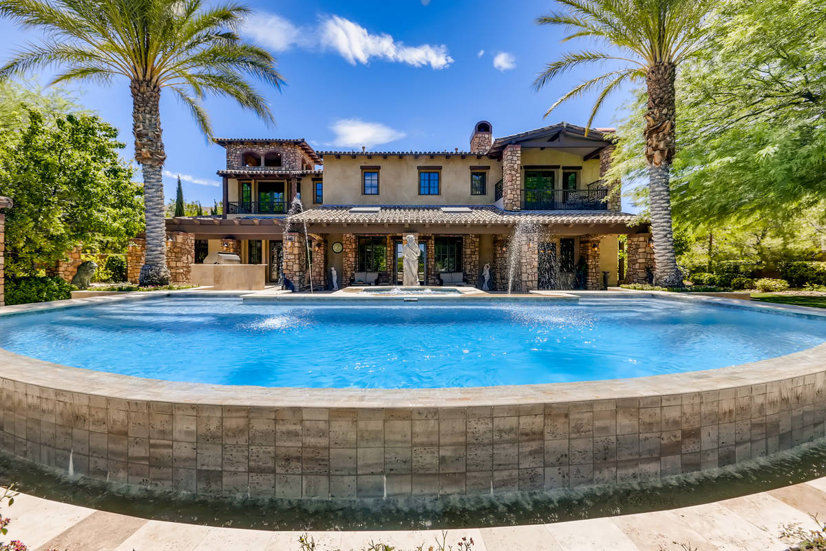 This home at 2 Olympia Hills Circle sits on the golf course at Southern Highlands Country Club. ...