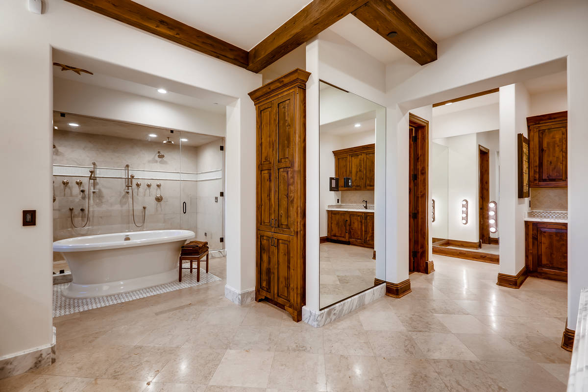 The large master bath has a large soaking tub that fills up from a tap in the ceiling. (The Cra ...