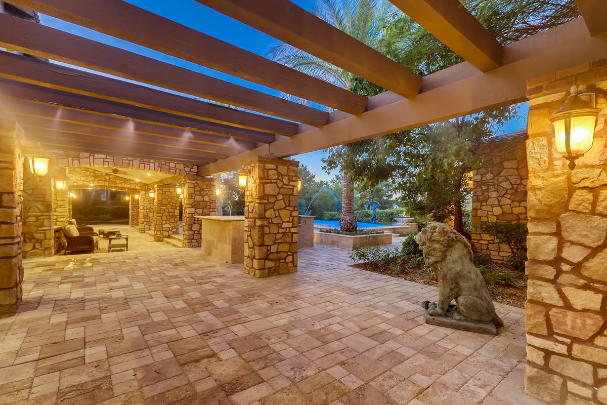 The outdoor patio of the Southern Highlands home stretches nearly the full length of the back o ...