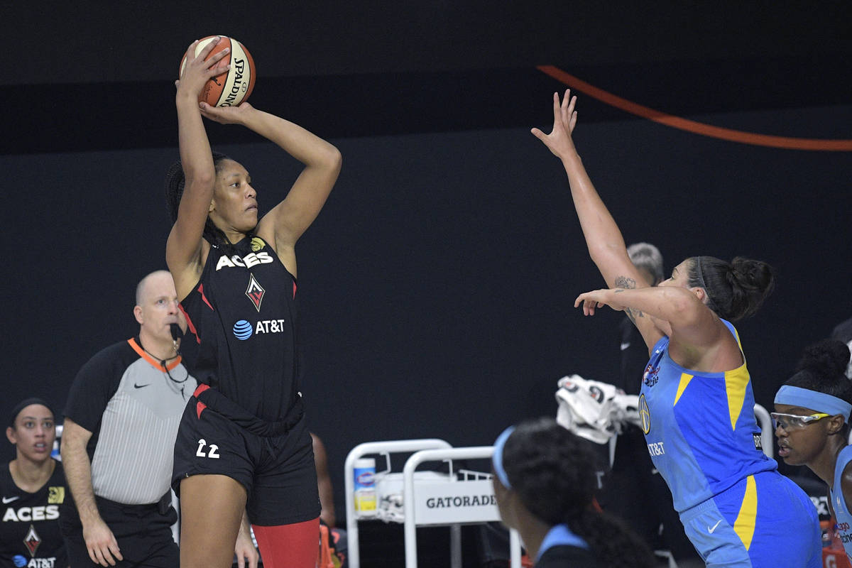 Las Vegas Aces center A'ja Wilson (22) goes up for a shot in front of Chicago Sky center Stefan ...