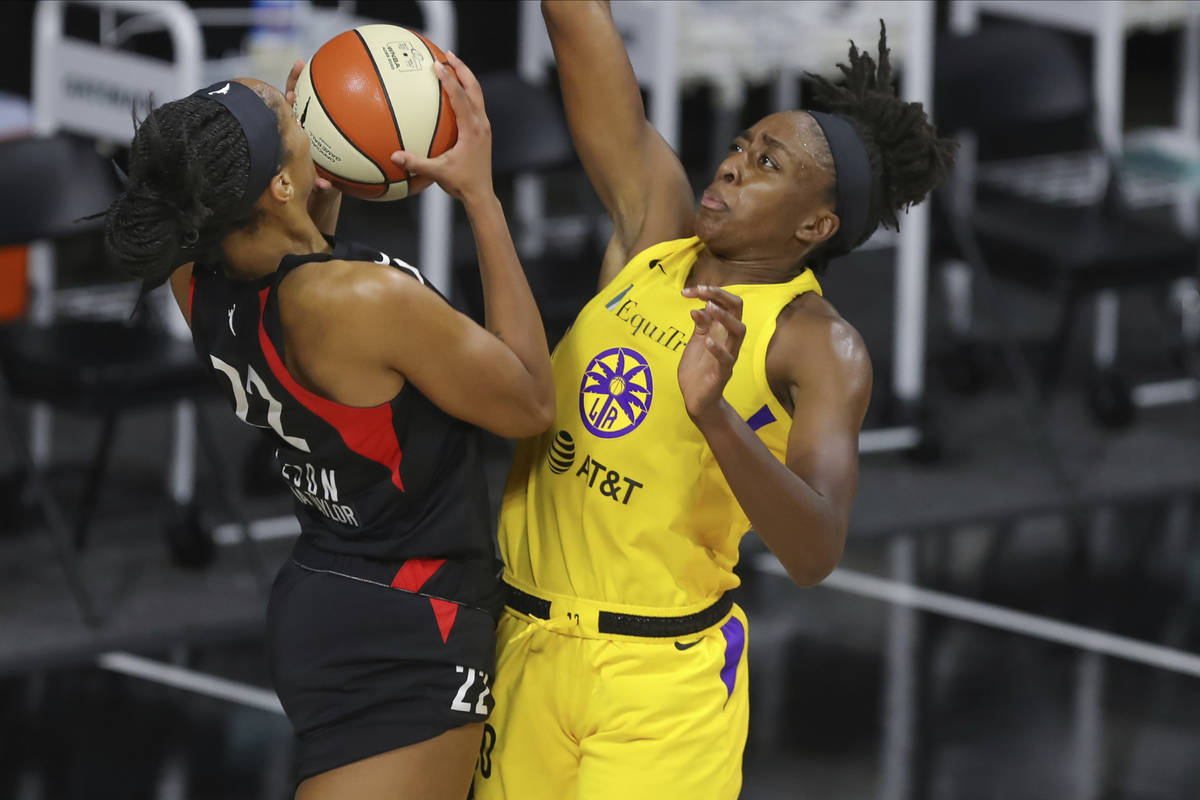 Las Vegas Aces' A'ja Wilson (22) shoots against Los Angeles Sparks' Nneka Ogwumike during the s ...