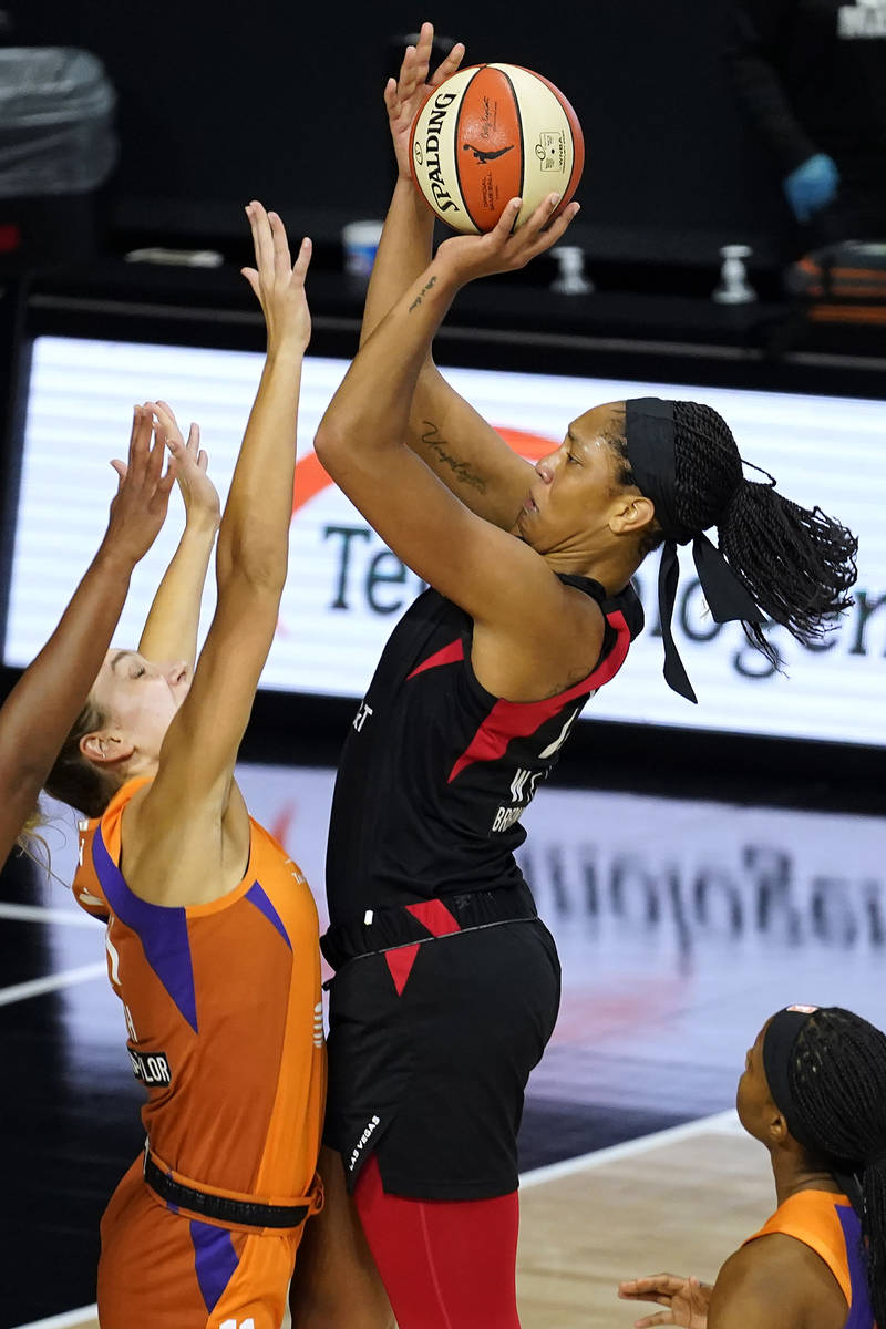 Las Vegas Aces center A'ja Wilson (22) shoots over Phoenix Mercury forward Alanna Smith (11) du ...