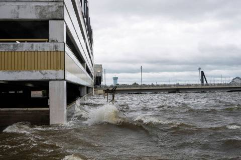 Storm surge from Hurricane Sally overtakes the outside parking lot and the first floor of the P ...