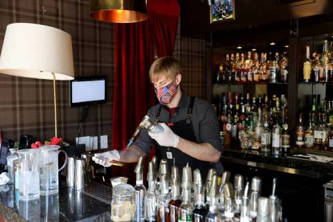 Bartender Erik Kluever makes an Apple Pie Harvest cocktail at Oak & Ivy in downtown Las Veg ...