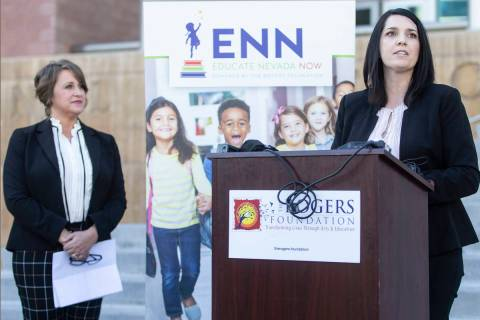 Amanda Morgan, right, executive director of Educate Nevada Now, speaks during a press conferenc ...