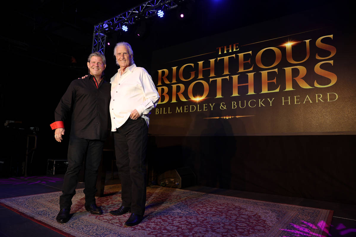 Bucky Heard, left, and Bill Medley of the Righteous Brothers pose for a photo after participati ...