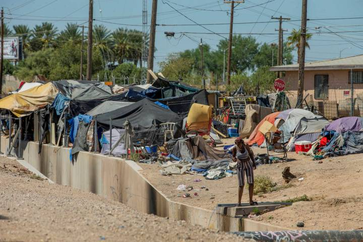 Homeless people begin their day as members of Food Not Bombs and the Sidewalk Project work to c ...