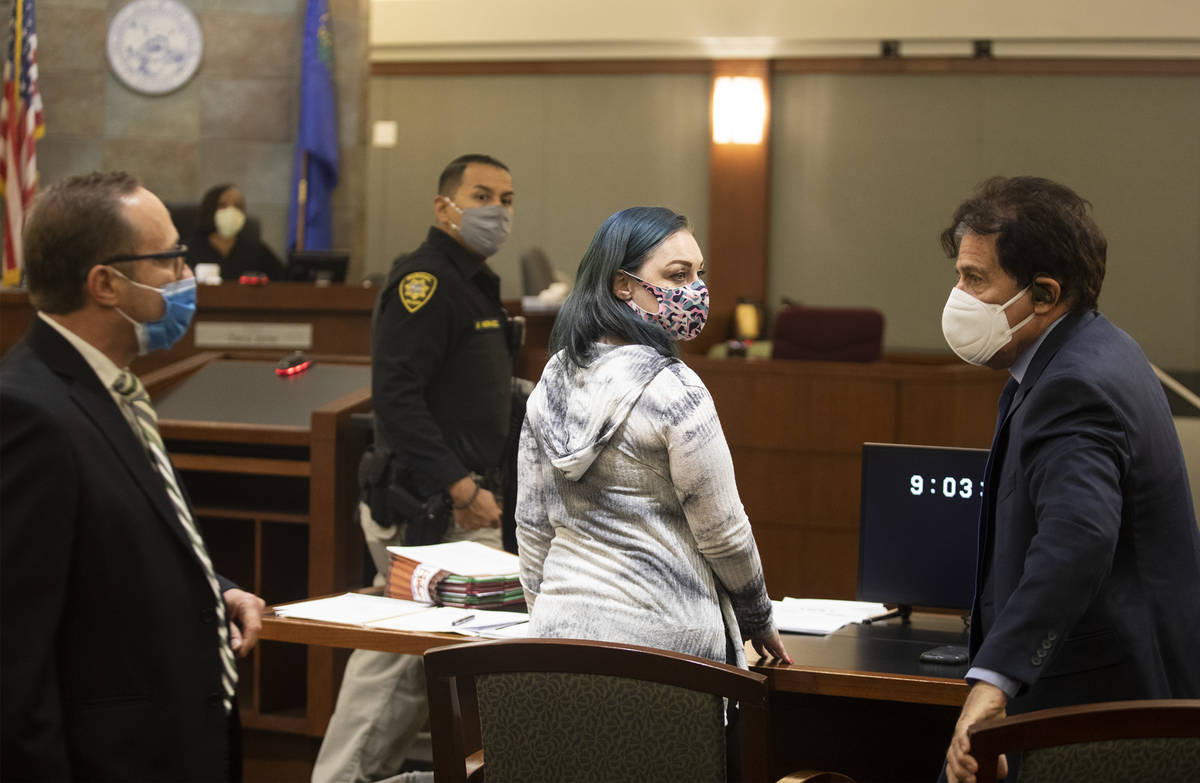 Alisha Burns makes her way to the stand next to her lawyer Tony Abbatangelo, left, and law cler ...
