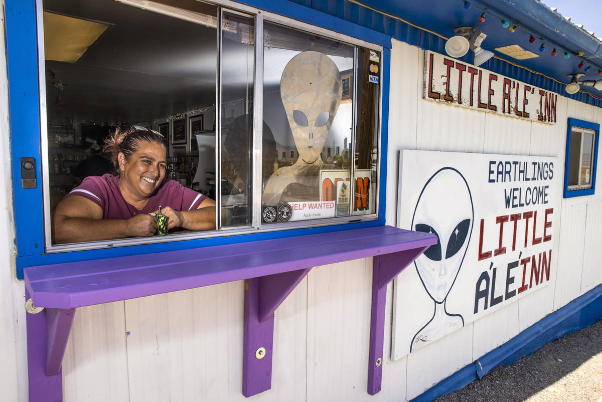 Connie West is her window service area at the Little A'Le'Inn which is open for business but a ...
