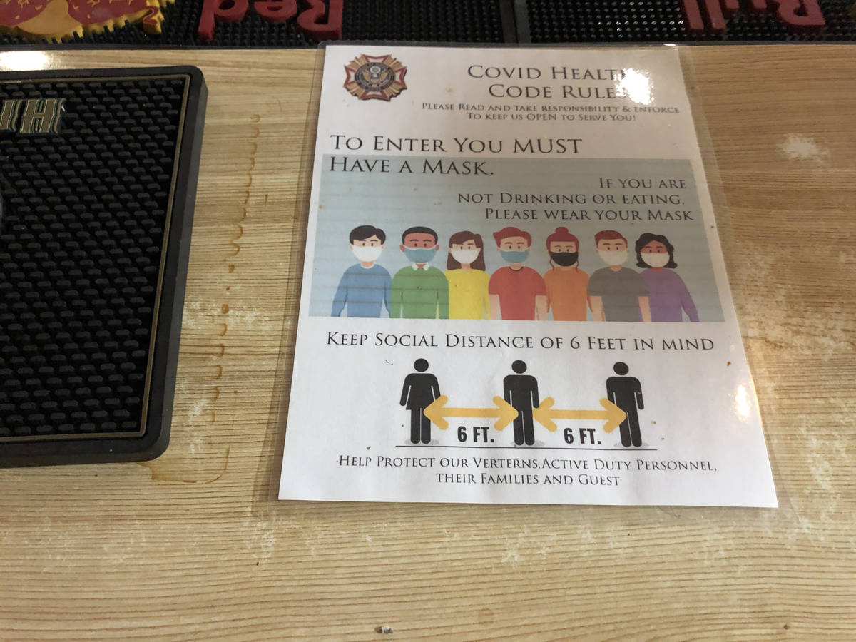Covid-19 guidelines at the VFW Post 10047 canteen's bar reminding patrons to keep distance and ...