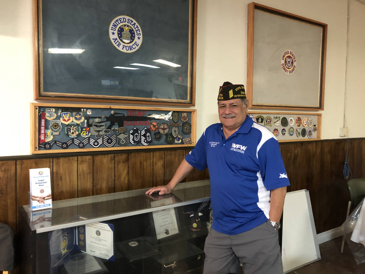"""Henry """"Butch"""" Beltran, 70, Nevada State VFW Commander posing in front of an Air Force display c ..."""
