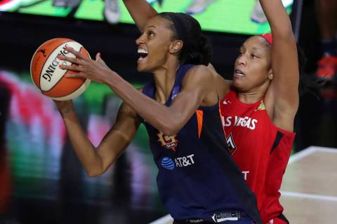 Connecticut Sun's DeWanna Bonner, left, drives past Las Vegas Aces' A'ja Wilson during the firs ...