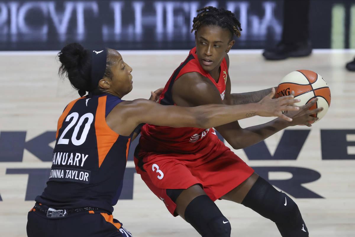 Las Vegas Aces' Danielle Robinson (3) avoids the defense of Connecticut Sun's Briann January du ...