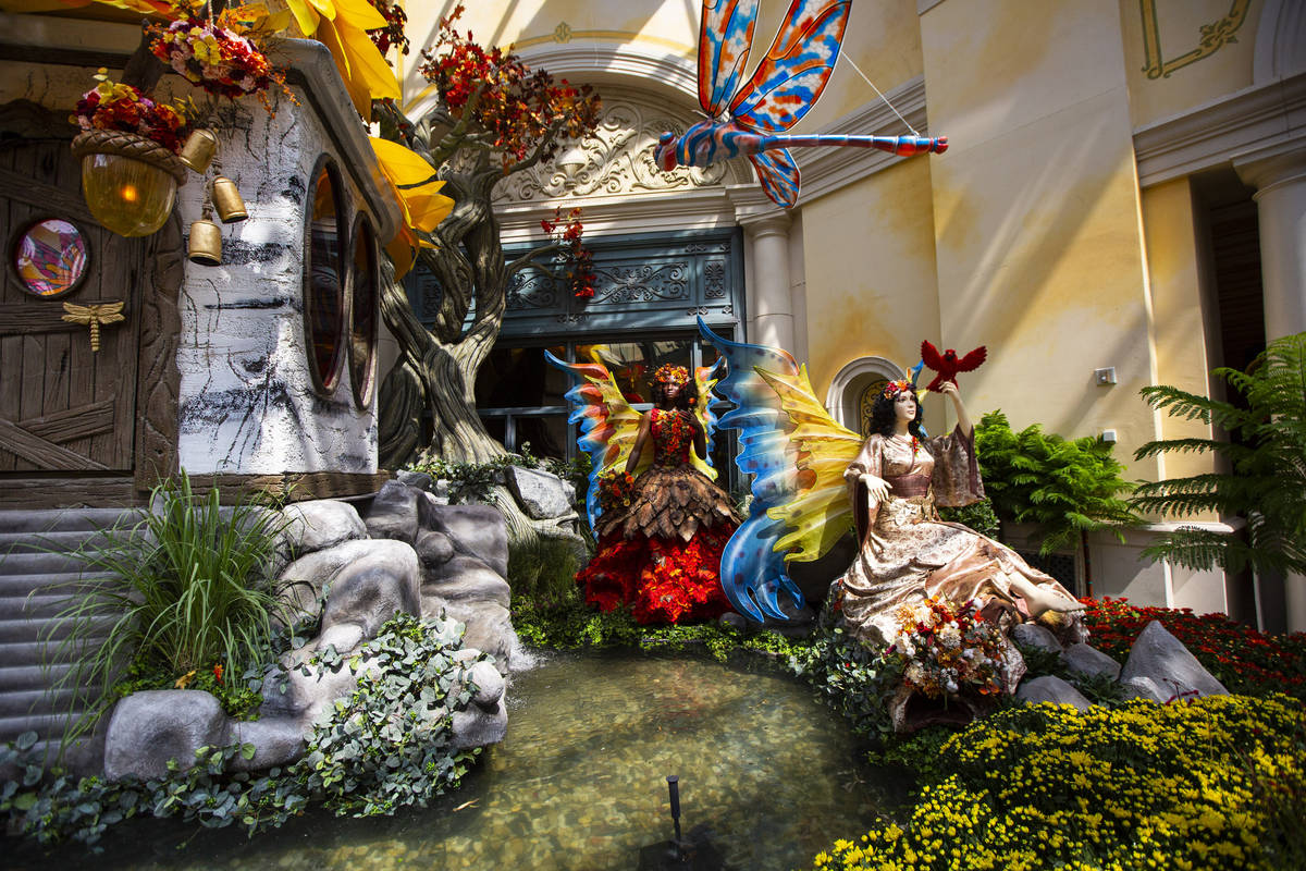 """A pair of fairies are part of the """"Into the Woods"""" fall display at the Bellagio Conservatory an ..."""