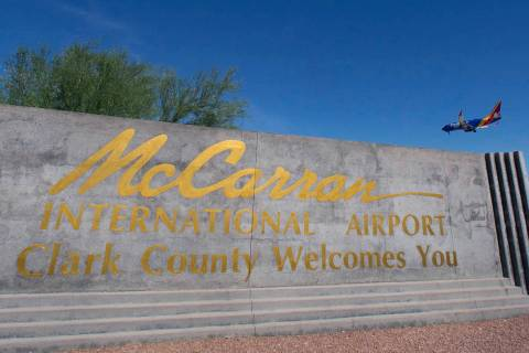 McCarran International Airport sign is seen as a Southwest Airways plane prepares to land on We ...