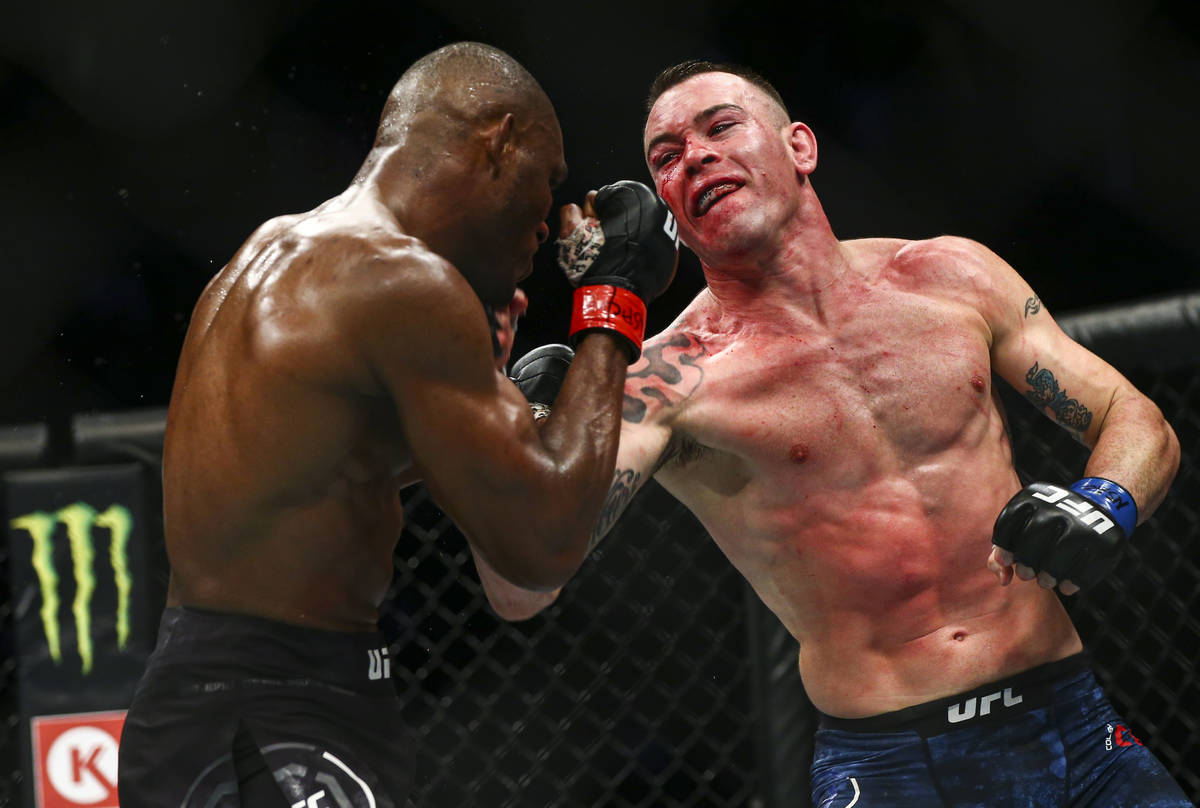 Kamaru Usman, left, fights Colby Covington during their welterweight title boutÊin UFC 245 ...