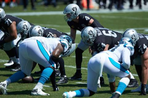 Las Vegas Raiders quarterback Derek Carr (4) lines up under center during the first half of an ...