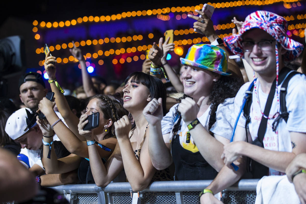 Fans react as Vampire Weekend performs at the downtown stage during day 3 of the Life is Beauti ...