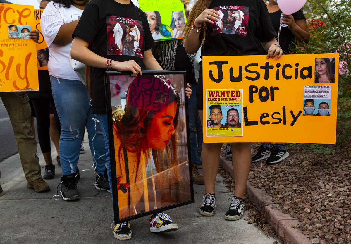 Family members hold pictures of Lesly Palacio, who was found slain near Valley of Fire State Pa ...